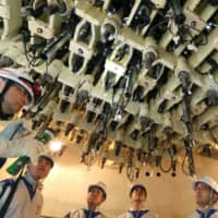 The underside of the reactor pressure vessel is seen inside the No. 3 reactor building at the Fukushima No. 2 nuclear power plant in Tomioka, Fukushima Prefecture, in January 2014.   | POOL / VIA BLOOMBERG