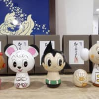 Merchandise at the Tezuka Osamu Shop & Cafe in Tokyo is displayed on July 4. | KYODO