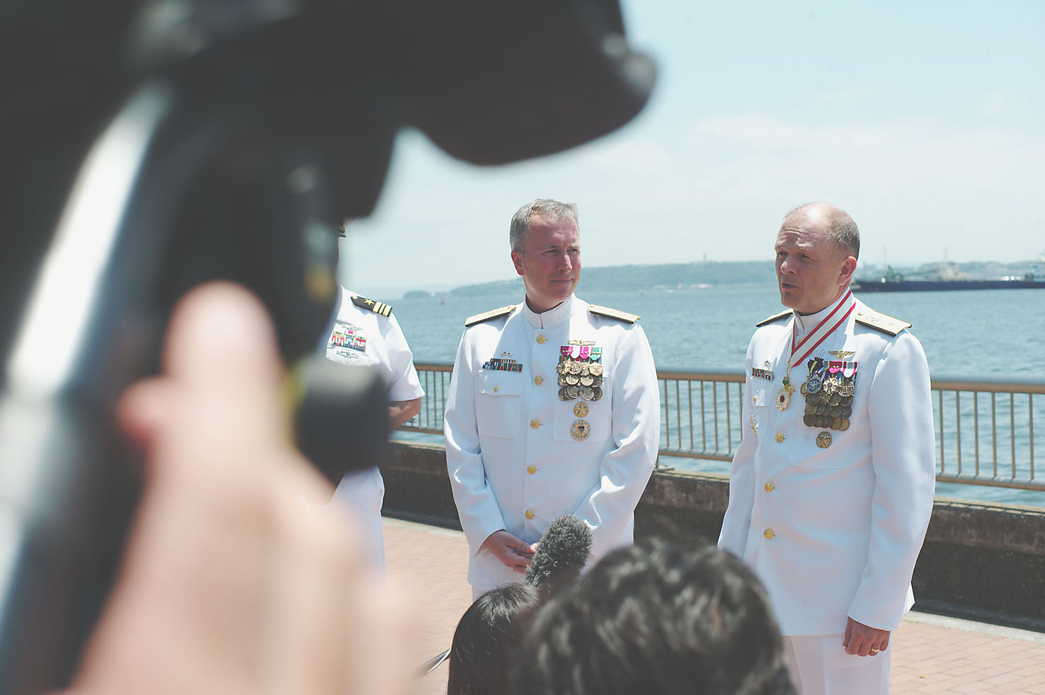 Rear Adms. Brian Fort (left) and Gregory Fenton speak to reporters in Yokosuka on Wednesday after a change-of-command ceremony in which Fort assumed command of U.S. naval forces in Japan from Fenton.   RYUSEI TAKAHASHI