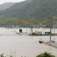 Rice paddies are seen flooded Monday after heavy rains in the town of Mashiki, Kumamoto Prefecture.   KYODO