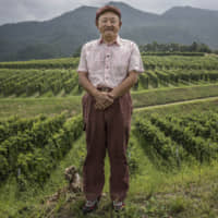 Mitsuhiro Anzo, chief winemaker of Mercian Corp., poses at the Chateau Mercian winery in Katsunuma, Yamanashi Prefecture, in 2018. Mercian, Japan's biggest and oldest winery, is nearly doubling its vineyards on expectations that its niche grapes — grown in a small area in the shadow of Mount Fuji — will increase sales both at home and overseas. | BLOOMBERG