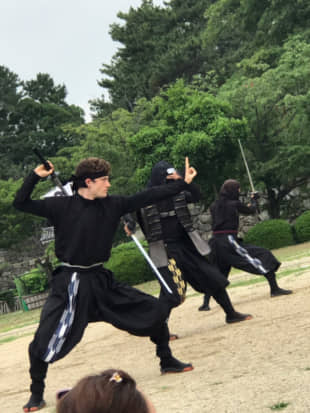 In action: John Patrick Janderosa performs at Nagoya Castle. He plays a character named Satori, who was also born in the United States. | @AICHI-NINJA