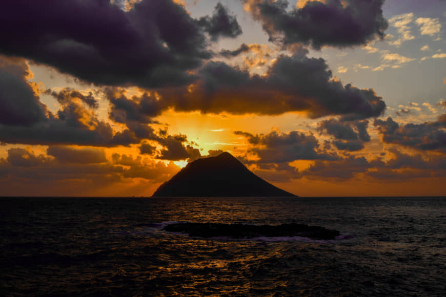No escape: Sunset over Hachijo-kojima island, Tokyo, where most of 'Battle Royale' (2000) was filmed.   GETTY IMAGES
