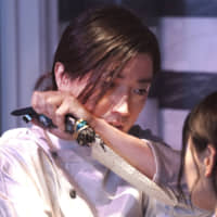 On a knife edge:  Tatsuya Fujiwara appears as a former hitman turned chef whose serving staff keep meeting mysterious ends in Mika Ninagawa's 'Diner.' | © 2019 'DINER' SEISAKU IINKAI