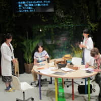 Practice makes perfect: The cast members of 'In the Heart of a Forest' run through the play during rehearsals, as a screen shows Japanese subtitles for the foreign-language dialogue.   NOBUKO TANAKA