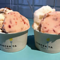 You don't have to pick just one: Gelateria Sincerita allows you to mix two flavors, such as mel noix (honey, milk and pecan) and cherry (left), or pineapple and cherry (right), in one cup. | PATRICK ST. MICHEL