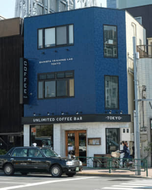 An Oshiage landmark: Unlimited Coffee Bar's blue-and-white coffee shop sits in the shadow of the Tokyo Skytree. | CLAIRE WILLIAMSON