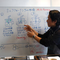 Technique and training: Unlimited co-owner Daichi Matsubara explains how to properly foam milk for espresso during a class at the Barista Training Lab Tokyo. | CLAIRE WILLIAMSON