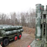 A file photo shows a new S-400 surface-to-air missile system after its deployment at a military base outside the town of Gvardeysk near Kaliningrad, Russia, on March 11.   REUTERS