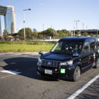 The introduction of wheelchair-friendly taxis is just one way that Japan is trying to make the 2020 Tokyo Summer Olympics and Paralymics as barrier-free as possible. | BLOOMBERG