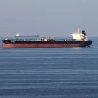 Oil tankers pass through the Strait of Hormuz last December. Japan faces a difficult question of whether to join escort operations in the waterways near Iran. | REUTERS