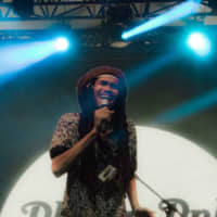 Faking it: Elbee Thrie of Phony Ppl entertained the crowd in the Red Marquee on Sunday.   RIKO MONMA