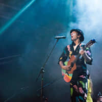 Colorful crooner: Jason Mraz was tasked with warming up for The Cure on Sunday.   RIKO MONMA