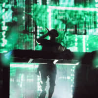 Light show: Martin Garrix brought pyrotechnics and lasers to the Green Stage on Saturday.   RIKO MONMA