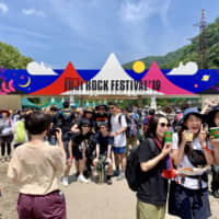 Sun-seekers: Around 130,000 people attended the festival over its four days.   ALYSSA I. SMITH