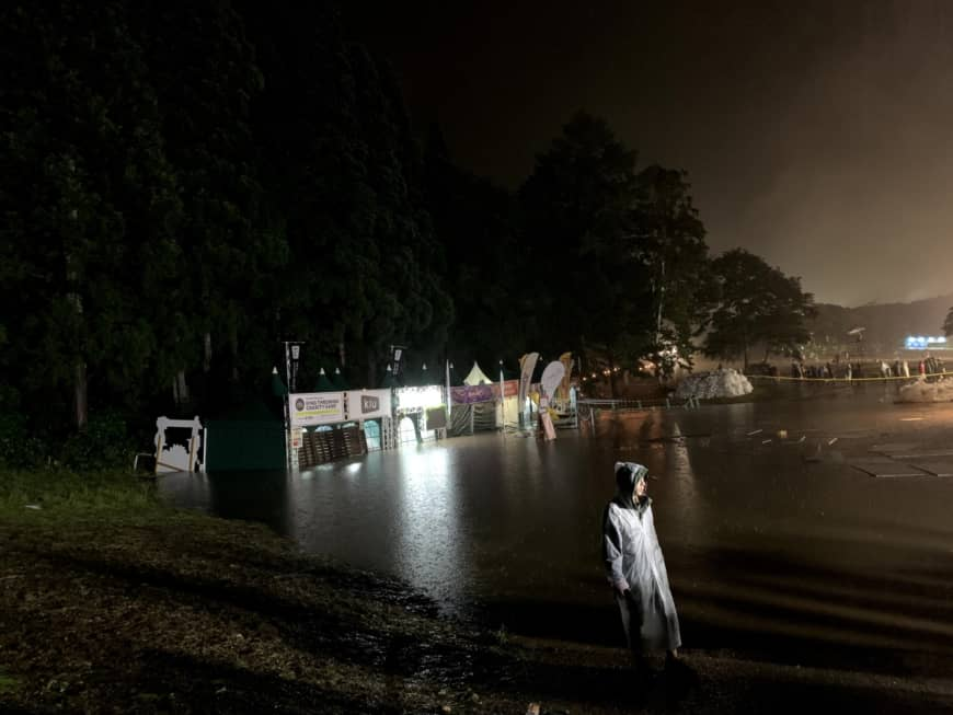 Wet and wild: Torrential rain on Saturday led to flooding around the Fuji Rock site.   DARREN WILLIS