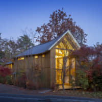 At home with nature: The exterior of Shishi-Iwa House emanates a glow at dusk in Karuizawa, Nagano Prefecture. | COURTESY OF SHISHI-IWA HOUSE