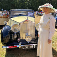 Time traveling in style: Kimberly Brangwin Milham adds an extra touch of authenticity to a classic car show in Seattle, Washington, with a dress she designed based on styles from 1915. | KIMBERLY BRANGWIN MILHAM