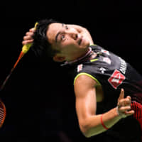 Kento Momota competes during the men's singles final at the Japan Open on Sunday at Musashino Forest Sports Plaza. | KYODO