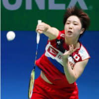Akane Yamaguchi hits a shot during her match against Nozomi Okuhara in the women's final at the Japan Open on Sunday. | KYODO