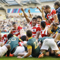 The Eddie Jones-led Brave Blossoms scored a 34-32 upset of South Africa on Sept. 18, 2015, in Brighton, England, at the Rugby World Cup. | KYODO