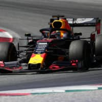 Red Bull's Max Verstappen secures first Formula One win for Honda since 2006