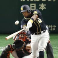 Tigers newcomer Yangervis Solarte smacks a two-run home run in the seventh inning against the Giants on Friday night at Tokyo Dome. Hanshin defeated Yomiuri 4-2. | KYODO