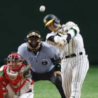 CL All-Star Fumihito Haraguchi slugs a two-run homer in the ninth inning on Friday. | KYODO