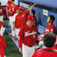 The Carp, seen in the visitors' dugout at Nagoya Dome during their contest against the Dragons on Wednesday, have lost 11 straight games. | KYODO