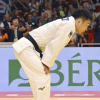 Three-time men's 73-kg champion Masashi Ebinuma reacts to his loss on the second day of the Budapest Grand Prix. | KYODO