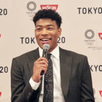 Rui Hachimura speaks during a news conference on Monday in Tokyo. | AP