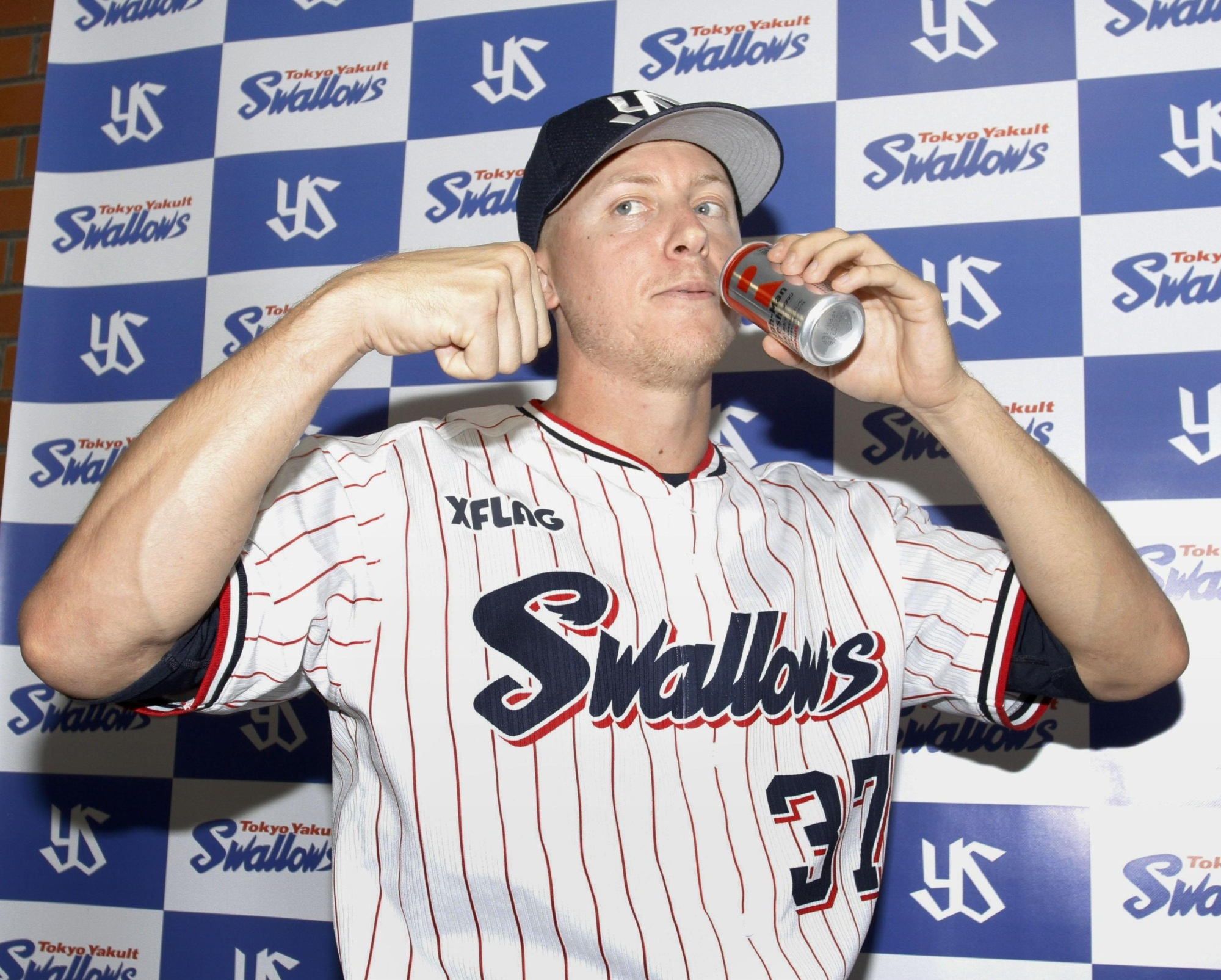 Tokyo Yakult Swallows All-Star pitcher Scott McGough poses for photographs after a game on Wednesday. | KYODO