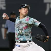 Marines starter Atsuki Taneichi pitches against the Fighters on Sunday at Sapporo Dome. | KYODO
