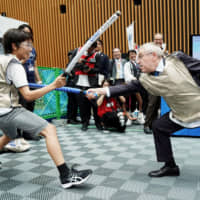International Olympic Committee President Thomas Bach, a former Olympic fencer, participates in a demonstration at an event in Tokyo on Wednesday.   POOL / VIA KYODO