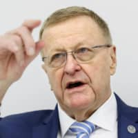 John Coates, chairman of the International Olympic Committee Coordination Commission, speaks at a news conference on Monday. | KYODO