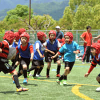 Rugby School of Ashiya students practice in Ashiya, Hyogo Prefecture, in June 2017. Wearing headgear is mandatory for children playing rugby  in Japan.   KYODO