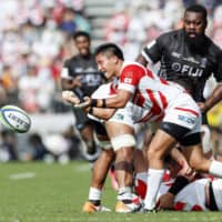 Kazuki Himeno of Japan passes the ball in the first half on Saturday against Fiji. | KYODO