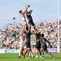 Japan (white and red) and Fiji vie for the ball in a lineout during the second half on Saturday. | KYODO