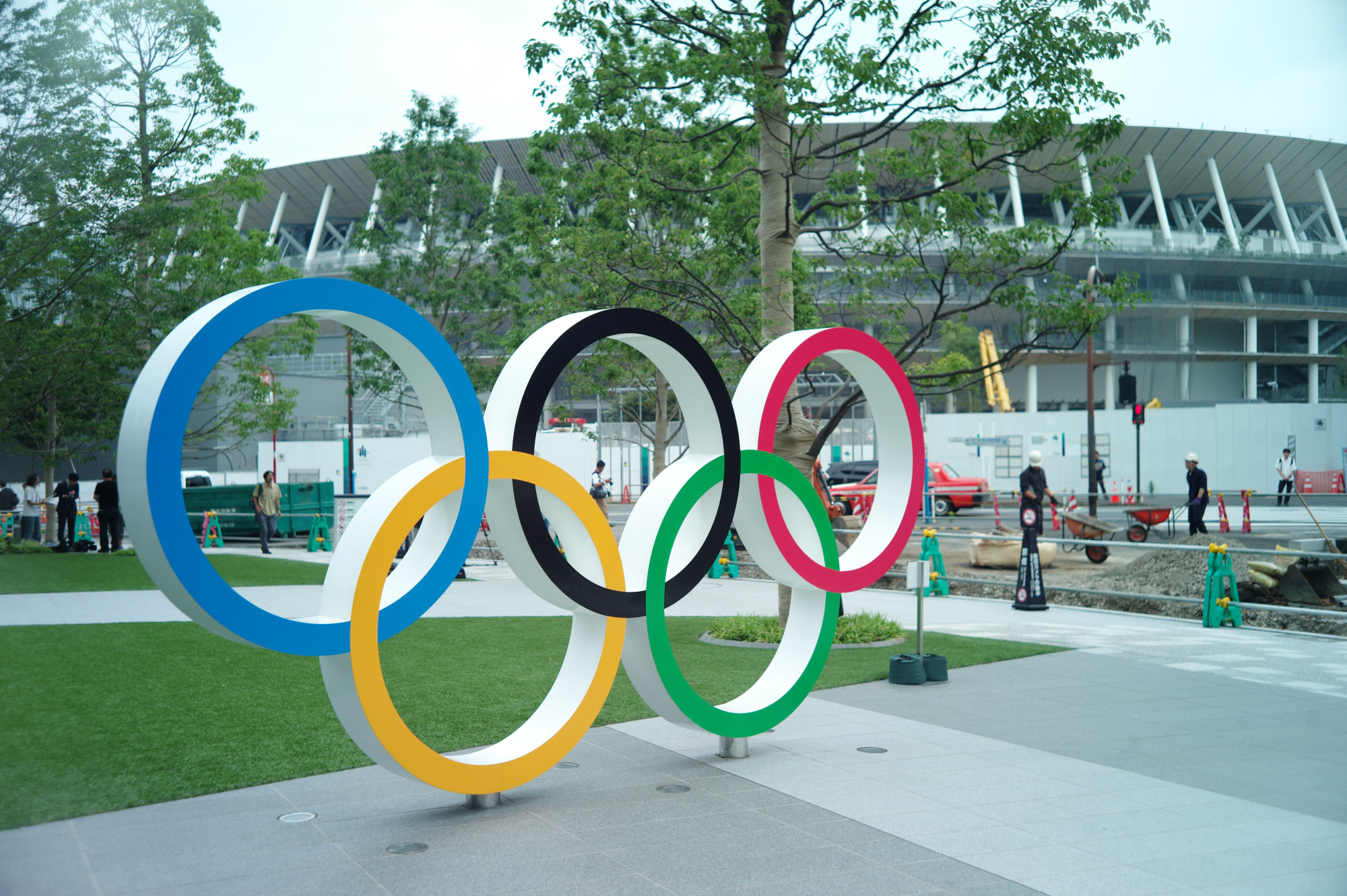 A statue of the Olympic rings stands near the new National Stadium, which is scheduled to be completed in November.   RYUSEI TAKAHASHI