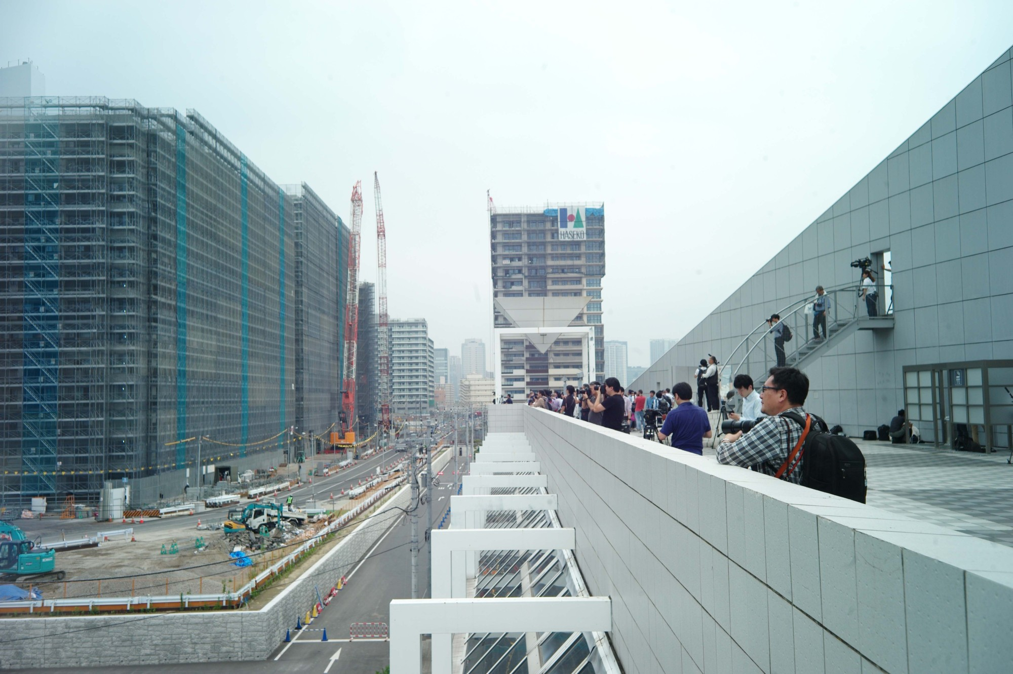 Media observe the Olympic and Paralympic Village in Chuo Ward for the first time.   RYUSEI TAKAHASHI