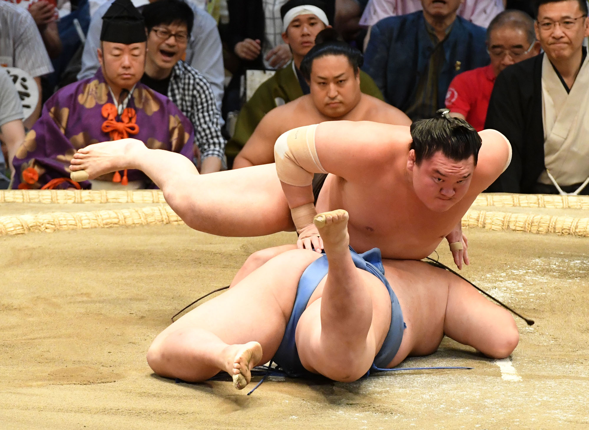 Hakuho lands on top of Shodai during their bout on the eighth day of the Nagoya Grand Sumo Tournament on Sunday at Dolphins Arena. The Mongolian yokozuna improved to 8-0. | NIKKAN SPORTS