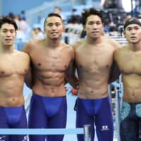 (From left) Akira Namba, Shinri Shioura, Katsuhiro Matsumoto and Katsumi Nakamura pose after their 4x100 men's freestyle relay heat at the swimming world championships on Sunday in Gwangju, South Korea. Their ninth-place finish earned Japan a berth in the event at the 2020 Tokyo Olympics. | KYODO