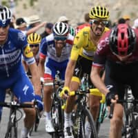 Julian Alaphilippe uses dramatic final descent in 18th stage to retain overall lead