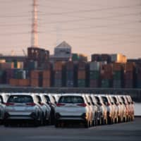 Toyota Motor Corp. Rush vehicles bound for shipment sit at the Nagoya Port in Tokai, Aichi Prefecture, in June. | BLOOMBERG