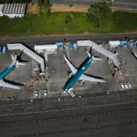 Unpainted Boeing 737 Max aircraft are seen parked in an aerial photo at Renton Municipal Airport near the Boeing Renton facility in Renton, Washington, July 1. | REUTERS