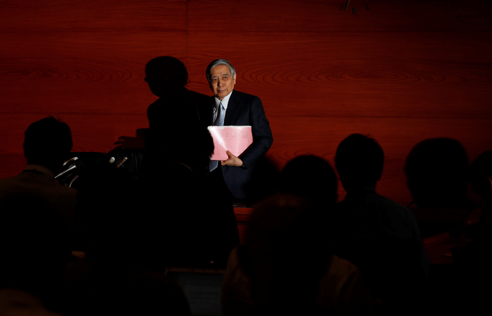 Bank of Japan Gov. Haruhiko Kuroda leaves after a news conference at BOJ headquarters in Tokyo on July 30. | REUTERS