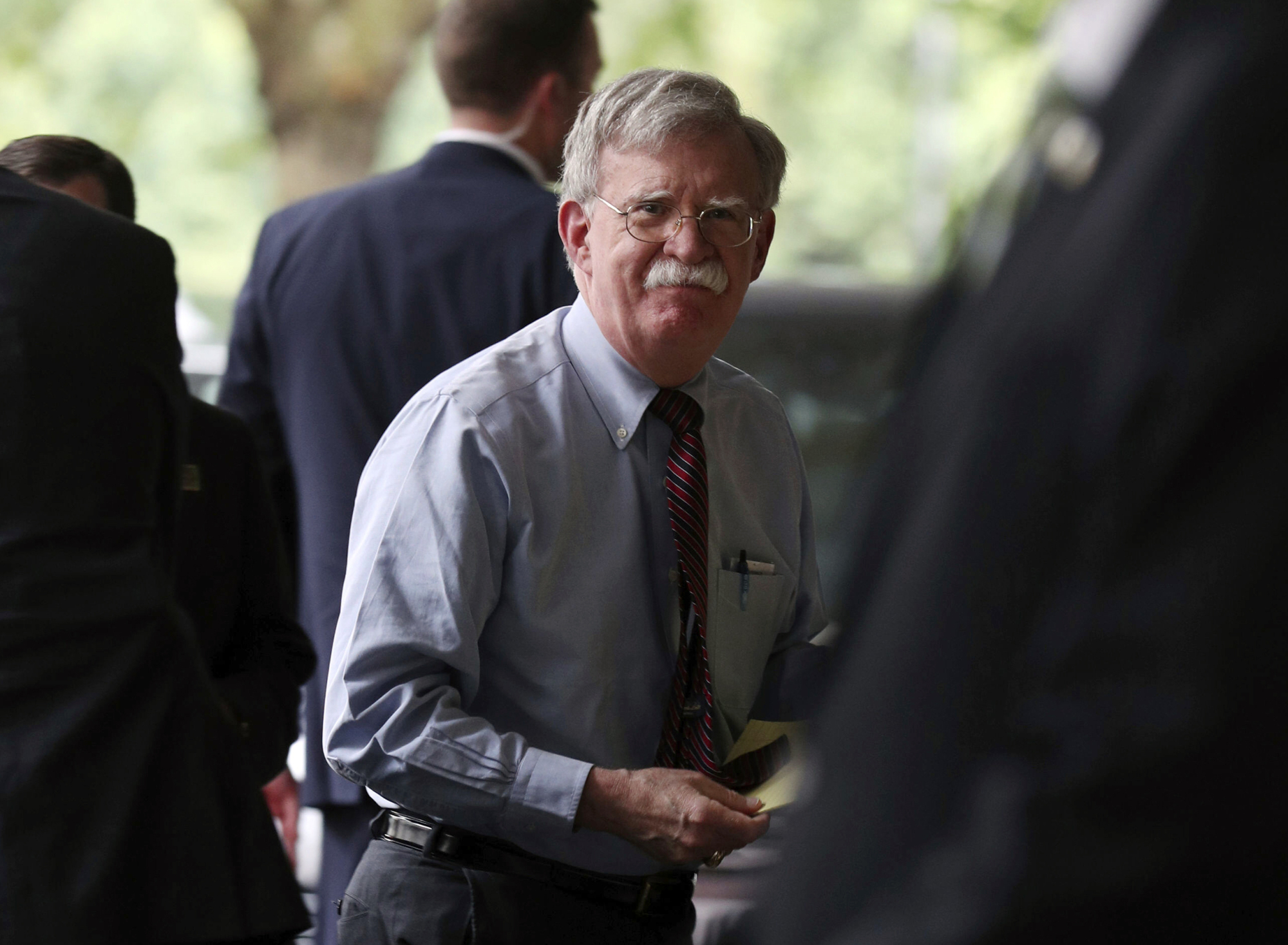 U.S. National Security Adviser John Bolton arrives to speak to members of the media at a hotel in central London Monday. U.S. President Donald Trump's national security adviser says the United States is ready to negotiate a post-Brexit trade deal with the U.K. 'in pieces' to help speed the process. Bolton met with British Prime Minister Boris Johnson on Monday, and their discussion covered Brexit, Hong Kong, Iran and other issues.   YUI MOK / PA / VIA AP