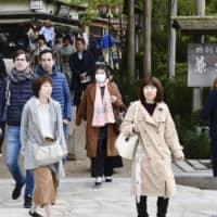 Tourists are seen at Kenrokuen Garden in Kanazawa, Ishikawa Prefecture, on April 27, at the start of the extended 10-day Golden Week holiday marking the imperial succession. Spending by consumers during the long vacation helped buoy the domestic economy, with government figures showing the nation's gross domestic product expanded at an annualized real rate of 1.8 percent during the April-June period. | KYODO