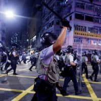 Police advance through the Sham Shui Po area of Hong Kong during clashes with anti-extradition bill protesters on August 14. | REUTERS