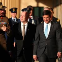 U.S. Secretary of Defense Mark Esper (right) walks with Australia's Chief of the Defence Force Gen. Angus Campbell (left) and Australian Secretary of the Department of Defense Greg Moriarty at Victoria Barracks in Sydney on Sunday. | AFP-JIJI